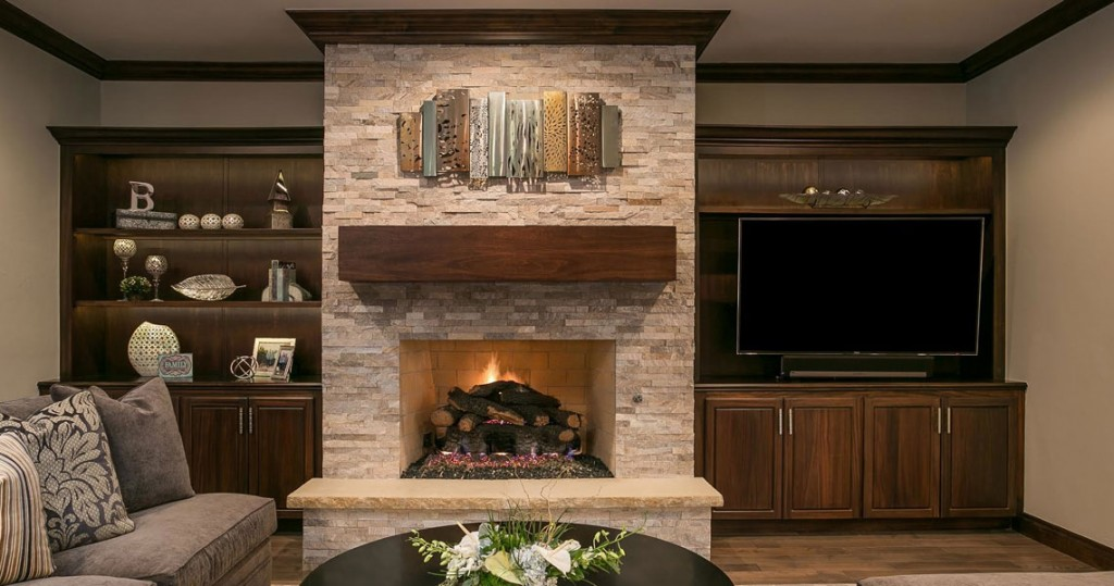 Dark wood cabinetry with brick fireplace and metal art picture