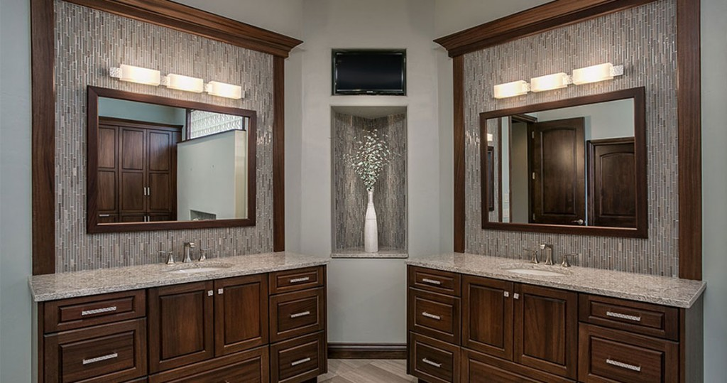 individual double vanities in master bathroom with vertical tile