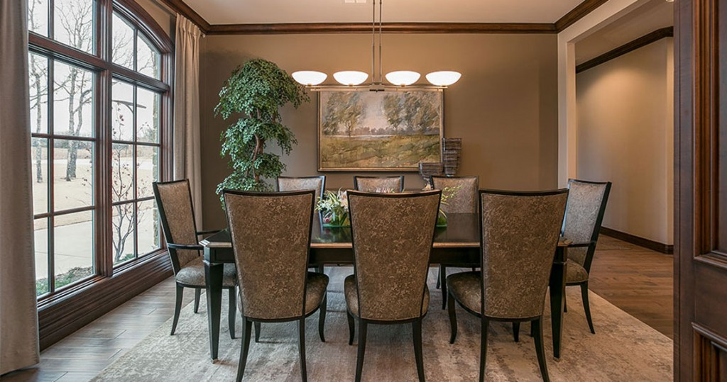 Formal dining room with Swaim furniture and contemporary lighting