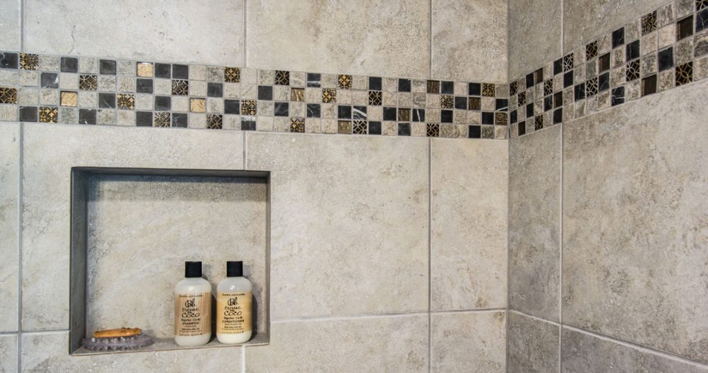 Close up of shower tile insert and soap niche