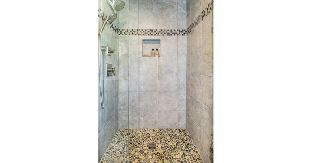 Small porcelain tile with smooth rock floor
