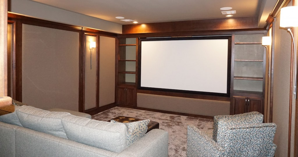 media room with large projector screen and acoustical wall