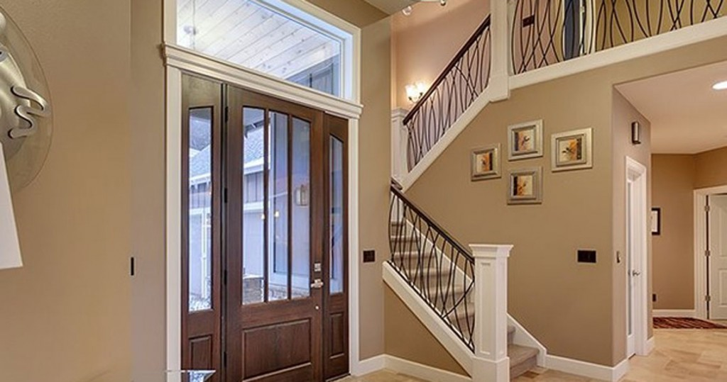 entry way with metal railing and stairway