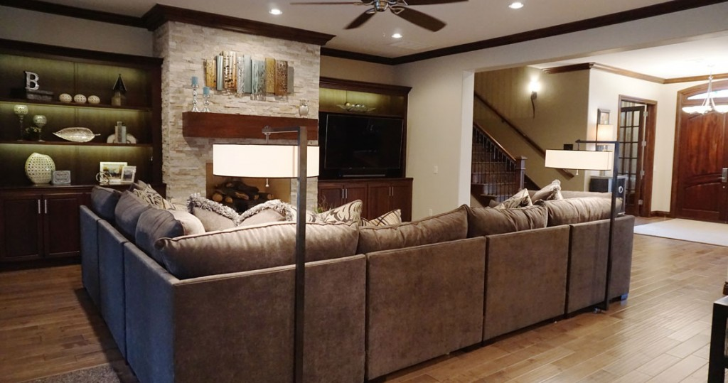 sectional furniture sofa in family room with TV and fireplace