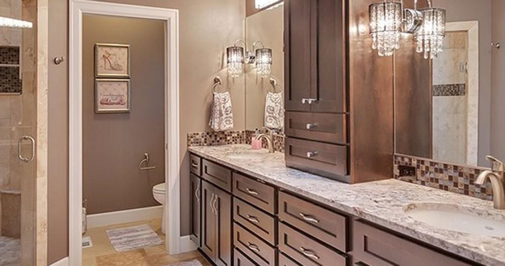 master bathroom, travertine floors, granite counter, dark cabinets