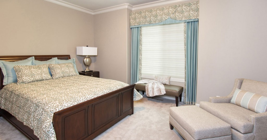 Bedroom with leopard print tuxedo valance and side panels