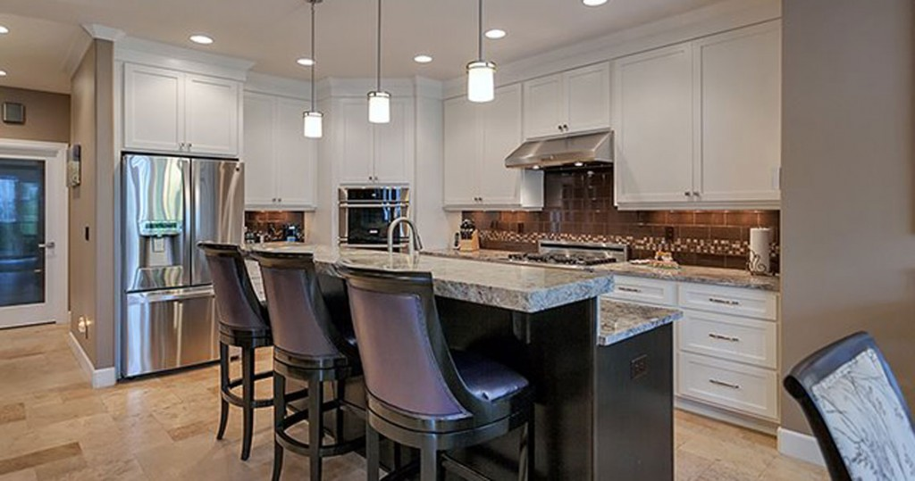 white cabinets in open kitchen with bar