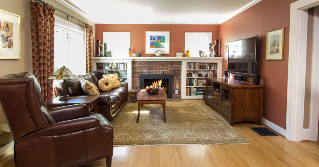 Craftsman style living room, drapery panels on rods, brick fireplace, furniture, area rug