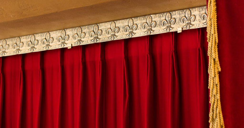 Gold metal embossed valance with red velvet motorized drapery panels