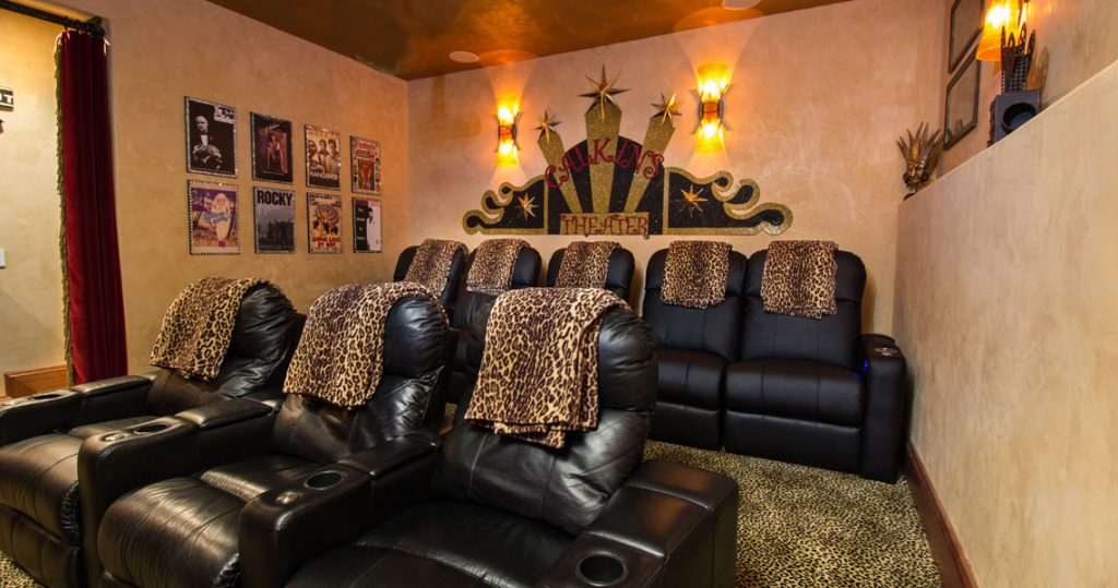 Stacked theatre seating with leopard print throws