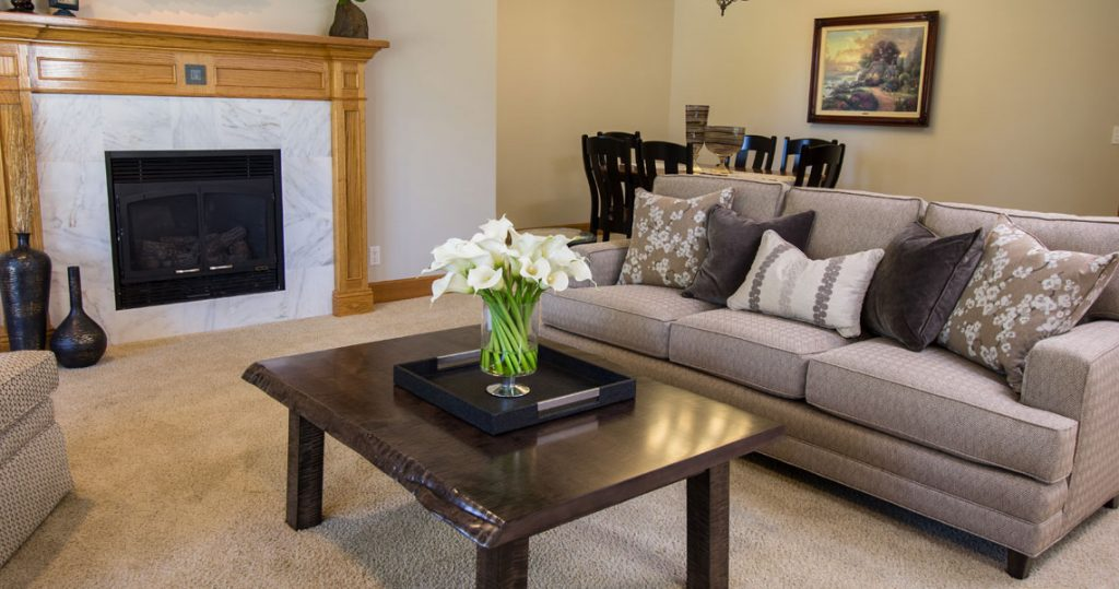 marble fireplace with harden sofa and coffee table