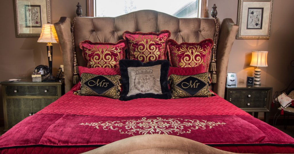 Bed with custom bedding, pillows and throw