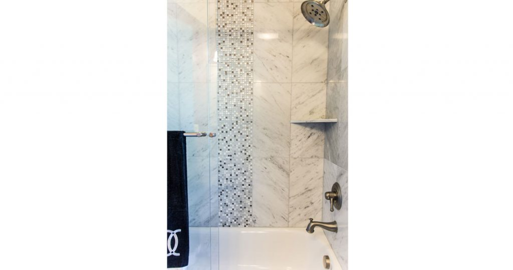 Marble tile shower with mosaic tile insert